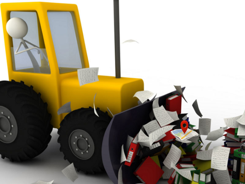 Traktor fjerner papir